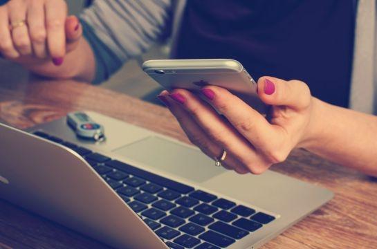 girl on computer keyboard smartphone