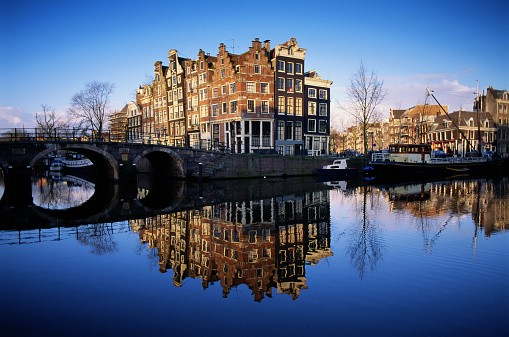 Holland, Amsterdam, arches in bridge over canals