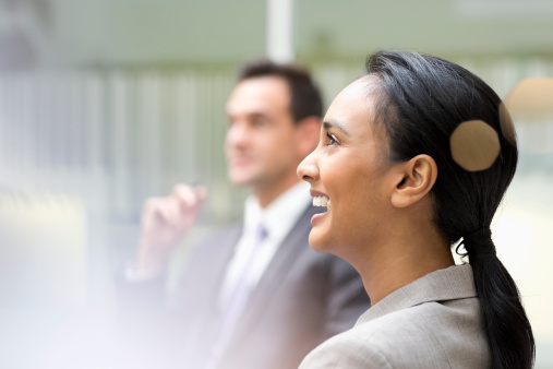 Businesswoman laughing in meeting