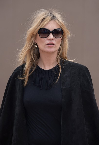 LONDON, ENGLAND - FEBRUARY 23: Kate Moss attends the Burberry Prorsum AW 2015 arrivals during London Fashion Week at Kensington Gardens on February 23, 2015 in London, England. (Photo by Gareth Cattermole/Getty Images for Burberry)