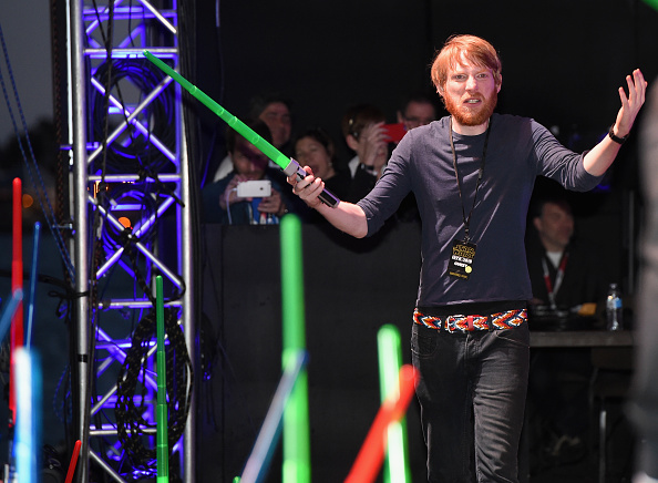 Here's Domhnall wielding a lightsaber at Comic-Con. Just because.