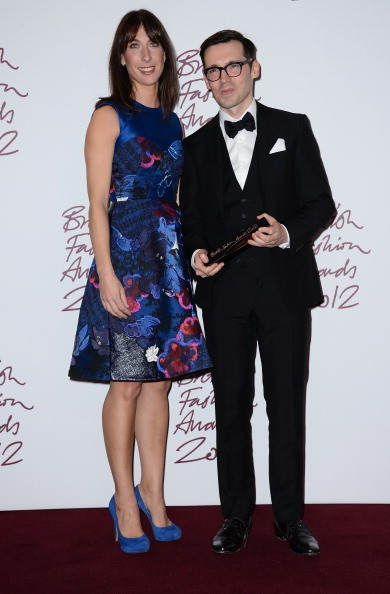 LONDON, ENGLAND - NOVEMBER 27:  Erdem Moralioglu, winner of the New Establishment award, poses with Samantha Cameron pose in the awards room at the British Fashion Awards 2012 at The Savoy Hotel on November 27, 2012 in London, England.  (Photo by Ian Gavan/Getty Images)