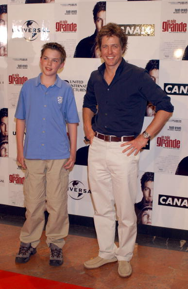 "MADRID, SPAIN - JUNE 18: Actors Nicholas Hoult (L) and Hugh Grant (R) attend the Spanish premier of the movie ""About a Boy"" June 18, 2002 at Palacio de la Musica Cinema in Madrid, Spain. (Photo by Carlos Alvarez/Getty Images)"