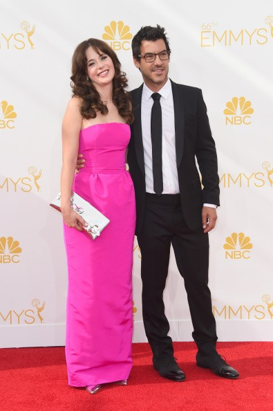 LOS ANGELES, CA - AUGUST 25:  Actress Zooey Deschanel (L) and producer Jacob Pechenik attend the 66th Annual Primetime Emmy Awards held at Nokia Theatre L.A. Live on August 25, 2014 in Los Angeles, California.  (Photo by Frazer Harrison/Getty Images)
