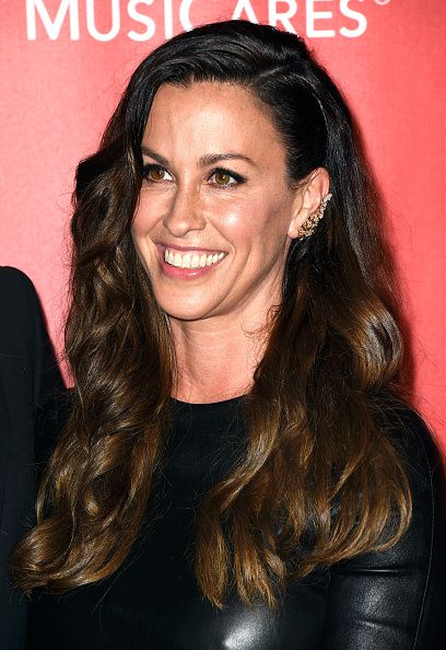 LOS ANGELES, CA - FEBRUARY 06: Singer Alanis Morissette attends the 25th anniversary MusiCares 2015 Person Of The Year Gala honoring Bob Dylan at the Los Angeles Convention Center on February 6, 2015 in Los Angeles, California. The annual benefit raises critical funds for MusiCares' Emergency Financial Assistance and Addiction Recovery programs. (Photo by Frazer Harrison/Getty Images)