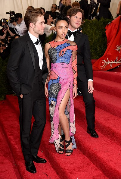 """NEW YORK, NY - MAY 04:  Robert Pattinson, FKA twigs and designer Christopher Kane attend the """"China: Through The Looking Glass"""" Costume Institute Benefit Gala at the Metropolitan Museum of Art on May 4, 2015 in New York City.  (Photo by Dimitrios Kambouris/Getty Images)"""