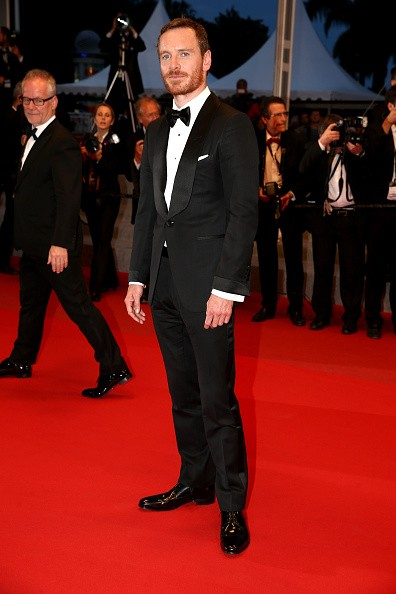 """CANNES, FRANCE - MAY 23:  Actor Michael Fassbender leaves the """"Macbeth"""" Premiere during the 68th annual Cannes Film Festival on May 23, 2015 in Cannes, France.  (Photo by Andreas Rentz/Getty Images)"""