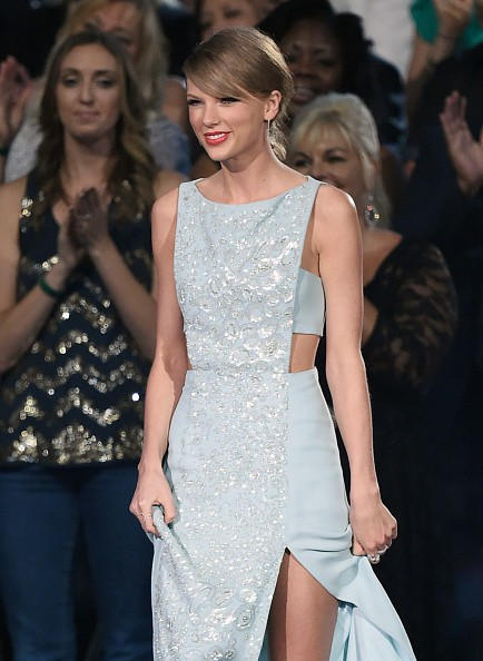 ARLINGTON, TX - APRIL 19:  Honoree Taylor Swift accepts the 50th Anniversary Milestone Award for Youngest ACM Entertainer of the Year during the 50th Academy of Country Music Awards at AT&T Stadium on April 19, 2015 in Arlington, Texas.  (Photo by Ethan Miller/Getty Images for dcp)