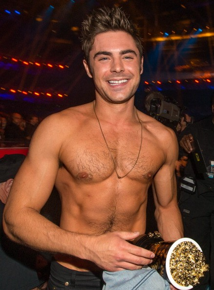 LOS ANGELES, CA - APRIL 13: Zac Efron (holding the Best Shirtless Performance award for'That Awkward Moment') attends the 2014 MTV Movie Awards at Nokia Theatre L.A. Live on April 13, 2014 in Los Angeles, California. (Photo by Christopher Polk/Getty Images for MTV)
