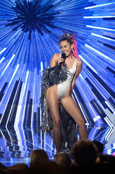 LOS ANGELES, CA - AUGUST 30:  Host Miley Cyrus, styled by Simone Harouche, holding a Samsung phone speaks onstage during the 2015 MTV Video Music Awards at Microsoft Theater on August 30, 2015 in Los Angeles, California.  (Photo by Kevork Djansezian/Getty Images)