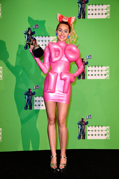 LOS ANGELES, CA - AUGUST 30:  Host Miley Cyrus poses in the press room with an MTV Video Music award at the 2015 MTV Video Music Awards at Microsoft Theater on August 30, 2015 in Los Angeles, California.  (Photo by Frazer Harrison/Getty Images)