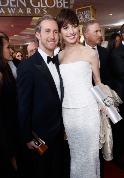 BEVERLY HILLS, CA - JANUARY 13: Actress Anne Hathaway (R) and husband Adam Shulman arrive at the 70th Annual Golden Globe Awards held at The Beverly Hilton Hotel on January 13, 2013 in Beverly Hills, California. (Photo by Alexandra Wyman/Getty Images for smartwater)