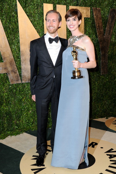 WEST HOLLYWOOD, CA - FEBRUARY 24: Actress Anne Hathaway (R) and Adam Shulman arrive at the 2013 Vanity Fair Oscar Party hosted by Graydon Carter at Sunset Tower on February 24, 2013 in West Hollywood, California. (Photo by Pascal Le Segretain/Getty Images)
