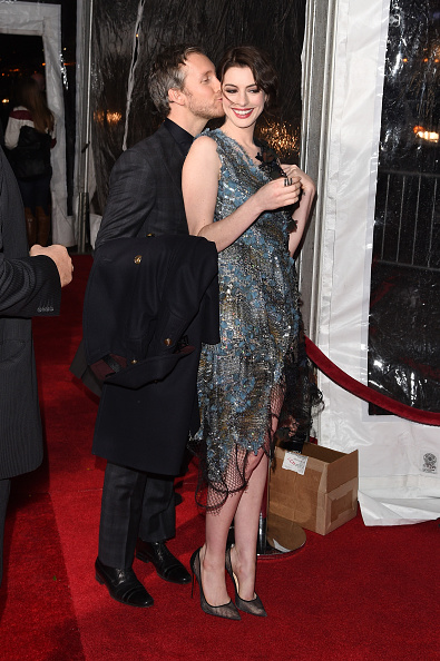 """NEW YORK, NY - NOVEMBER 03: Adam Shulman (L) and Anne Hathaway attend the """"Interstellar"""" New York premiere at AMC Lincoln Square Theater on November 3, 2014 in New York City. (Photo by Andrew H. Walker/Getty Images)"""