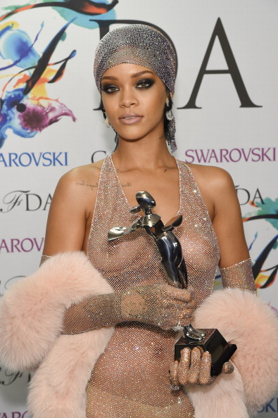 NEW YORK, NY - JUNE 02: (EDITORS NOTE: Image contains partial nudity.) Fashion Icon award recipient Rihanna attends the winners walk during the 2014 CFDA fashion awards at Alice Tully Hall, Lincoln Center on June 2, 2014 in New York City. (Photo by Larry Busacca/Getty Images)
