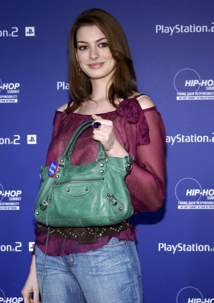 """NEW YORK - OCTOBER 14: Actress Anne Hathaway arrives at the Playstation 2 And The Hip-Hop Summit Present """"Race To The Polls"""" at Hammerstein Ballroom October 14, 2004 in New York City. (Photo by Fernando Leon/Getty Images)"""