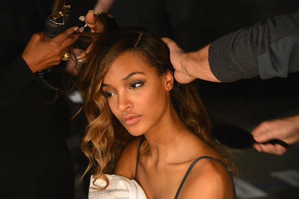 NEW YORK, NY - OCTOBER 20:  Model Jourdan Dunn prepares backstage at the BALMAIN X H&M Collection Launch at 23 Wall Street on October 20, 2015 in New York City.  (Photo by Slaven Vlasic/Getty Images for H&M)