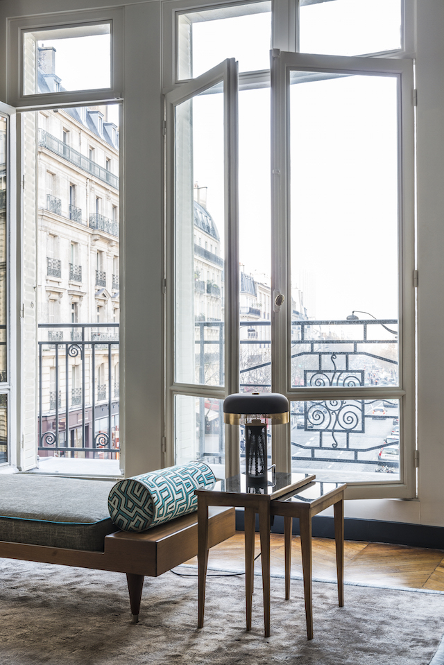 The living-room doors open onto a beautiful balcony in typical Parisian style.