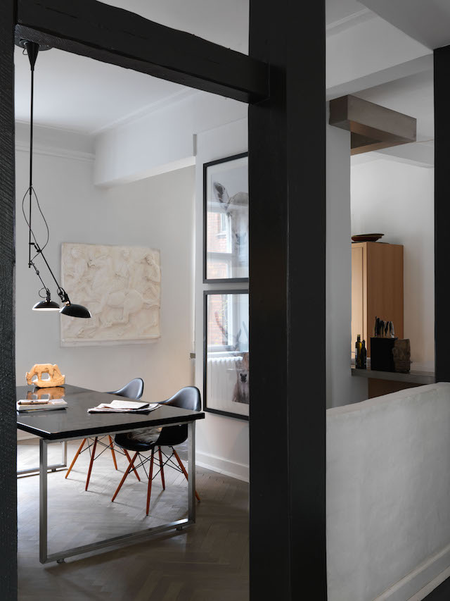 The plaster frieze, typical on the front of Scandinavian homes, makes a striking statement in the simple dining-room space, as does the black enamel pendant light, originally a floor lamp but adapted to hang over the table.