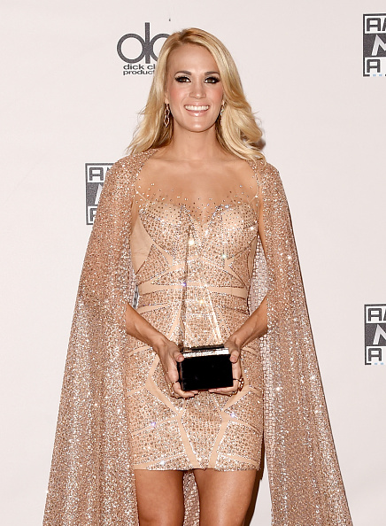 LOS ANGELES, CA - NOVEMBER 22:  Recording artist Carrie Underwood, winner of Favorite Country Female Artist, poses in the press room during the 2015 American Music Awards at Microsoft Theater on November 22, 2015 in Los Angeles, California.  (Photo by Jason Merritt/Getty Images)