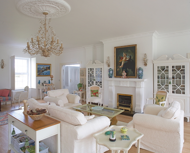 The living room has opulent touches but a distinct country feel.