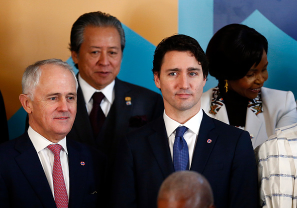 VALLETTA, MALTA - NOVEMBER 27: Australia's Prime Minister Malcolm Turnbull (L) stands next to Canada's Prime Minister Justin Trudeau (2nd R) as they pose for a family photo at CHOGM opening ceremony at the Mediterranean Conference Centre on November 27, 2015 near Valletta, Malta. Queen Elizabeth II, The Duke of Edinburgh, Prince Charles, Prince of Wales and Camilla, Duchess of Cornwall arrived yesterday to attend the Commonwealth Heads of State Summit. (Photo by Andrew Winning-Pool/Getty Images)