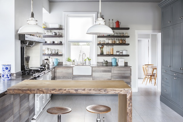From our March-April issue; owners of two of Belfast's best-known vintage businesses - ReFound and On the Square; the kitchen cupboards are reclaimed ash with a reclaimed oak floating-shelf. Photography by Ruth Maria Murphy.