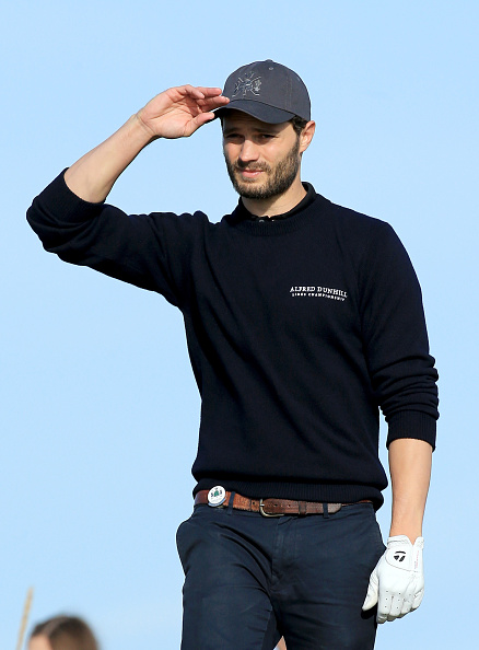 CARNOUSTIE, SCOTLAND - OCTOBER 02: British actor Jamie Dornan on the second hole during the first round of the 2014 Alfred Dunhill Links Championship at the Championship Links at Carnoustie on October 2, 2014 in Carnoustie, Scotland. (Photo by David Cannon/Getty Images)