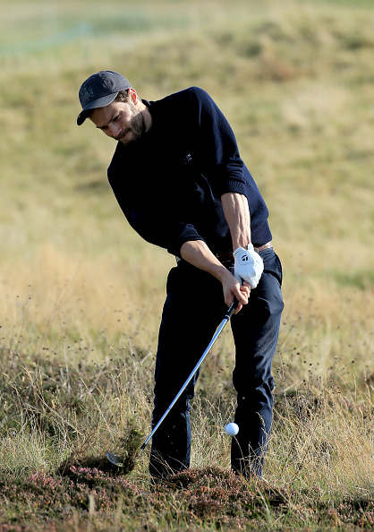 CARNOUSTIE, SCOTLAND - OCTOBER 02: British actor Jamie Dornan plays his second shot to the fifth hole during the first round of the 2014 Alfred Dunhill Links Championship at the Championship Links at Carnoustie on October 2, 2014 in Carnoustie, Scotland. (Photo by David Cannon/Getty Images)