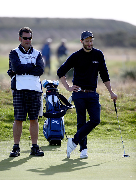 CARNOUSTIE, SCOTLAND - OCTOBER 02: British actor Jamie Dornan on the fourth green during the first round of the 2014 Alfred Dunhill Links Championship at the Championship Links at Carnoustie on October 2, 2014 in Carnoustie, Scotland. (Photo by Matthew Lewis/Getty Images)