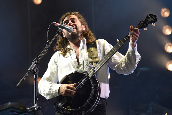 Winston Marshall performs on stage.