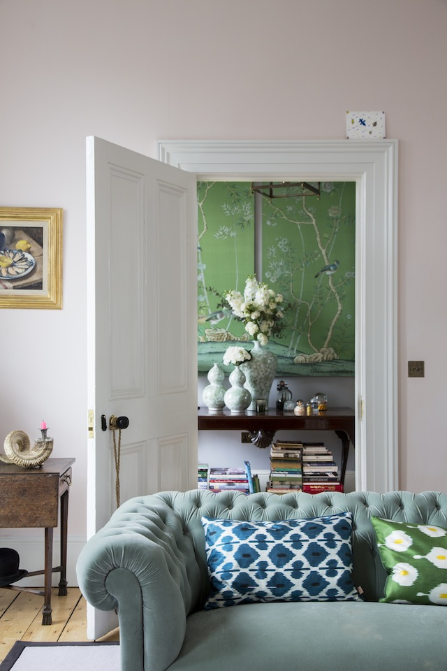 The De Gournay framed wallpaper panels bring the hallway to life.
