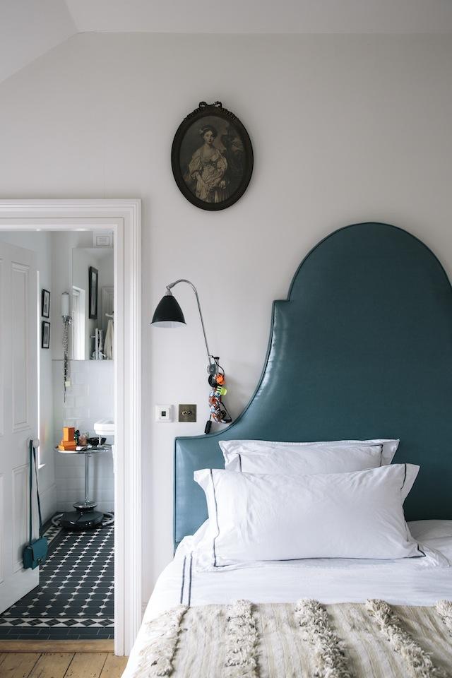 Peter Johnson designed the master bedhead like Stockholm's rooftops.