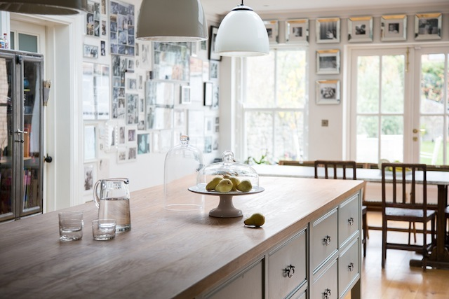 The kitchen is designed by Andrew Ryan and painted in Farrow & Ball's Light Blue.