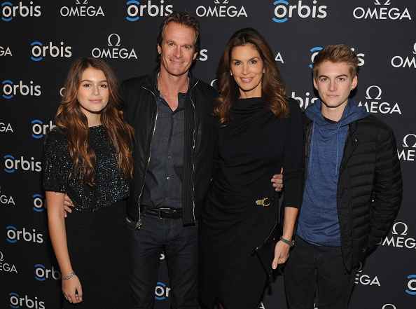 "NEW YORK, NY - FEBRUARY 05: (L-R) Model Kaia Jordan Gerber, Businessman Rande Gerber, model, OMEGA Brand Ambassador Cindy Crawford and Presley Walker Gerber attend the screening of ""The Hospital In The Sky"" presented by OMEGA at New York Historical Society on February 5, 2015 in New York City. (Photo by Craig Barritt/Getty Images for Omega)"