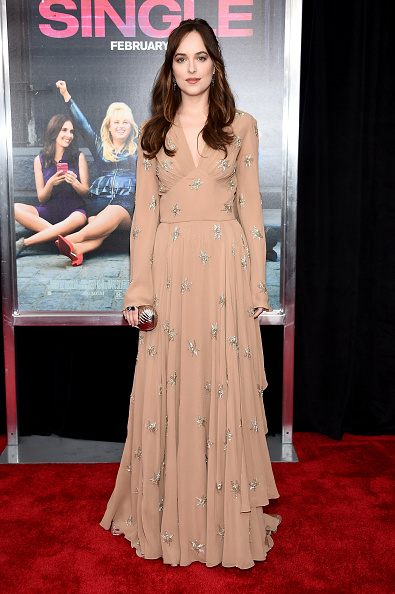 """NEW YORK, NY - FEBRUARY 03: Actress Dakota Johnson attends the New York premiere of """"How To Be Single"""" at the NYU Skirball Center on February 3, 2016 in New York City. (Photo by Dimitrios Kambouris/Getty Images)"""