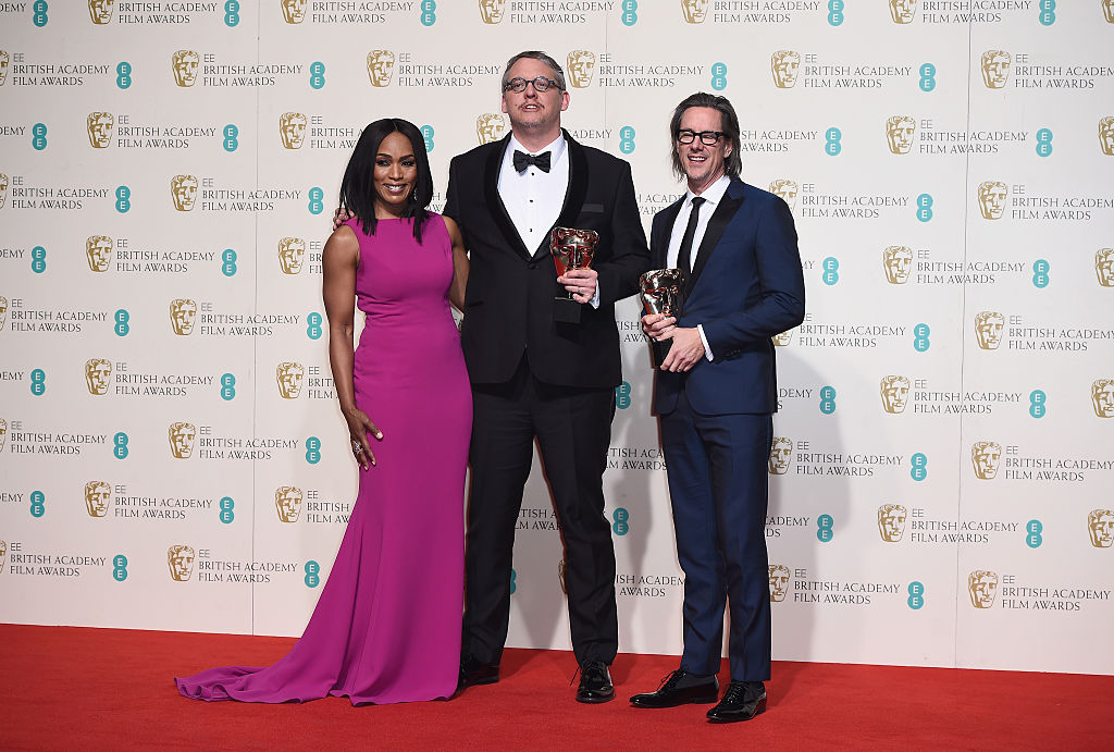 LONDON, ENGLAND - FEBRUARY 14: Angela Bassett poses with Best Adapted Screenplay winners Adam McKay and Charles Randolph in the winners room at the EE British Academy Film Awards at the Royal Opera House on February 14, 2016 in London, England. (Photo by Ian Gavan/Getty Images)