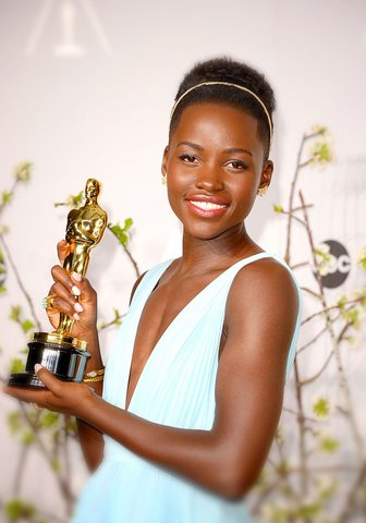 Lupita Nyong?o's luminous skin and cute hairband elevate a simplistic beauty look.