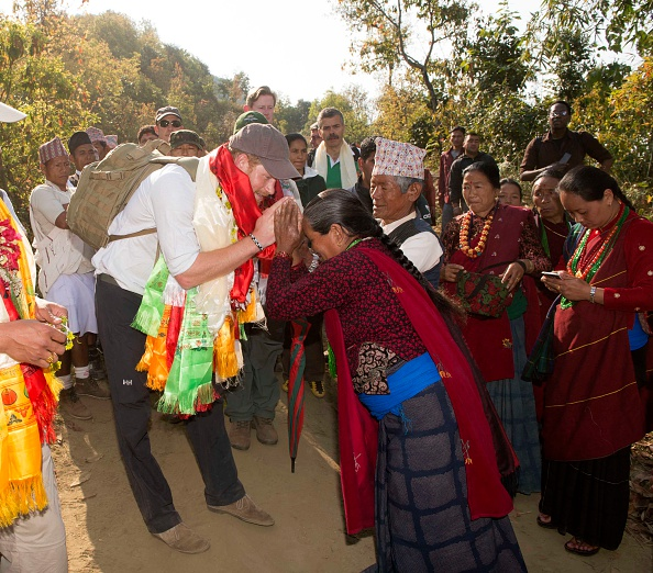 OKHARI, NEPAL - MARCH 22: Prince Harry is given garlands and flowers as he visits Gauda Secondary School, an earthquake-damaged school being reconstructed with assistance from the Gurkha Welfare Scheme, in the Himalayan village of Okhari on day four of his visit to Nepal on March 22, 2016 in Okhari, Nepal. Prince Harry is on a five day visit to Nepal, his first official tour of the country. (Photo by Paul Edwards - Pool/Getty Images)