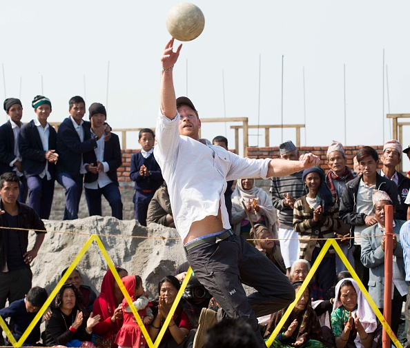 Prince Harry Nepal visit day 4 Prince Harry visiting Gauda Secondary School, Okhari earthquake-damaged school, which is being reconstructed with assistance from the Gurkha Welfare Scheme. The Prince is given garlands and flowers and plays volley ball with local school children See story by Emily Andrews Picture by Paul Edwards .