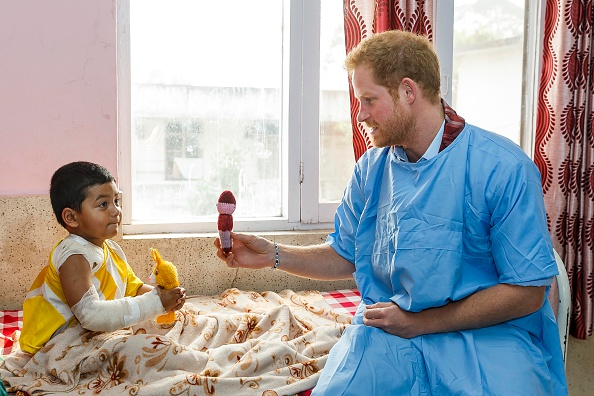 KATHMANDU, NEPAL - MARCH 23: Prince Harry meets young burns victim Biplov Puri, 4 at Kanti Children's Hospital on the final day of his tour of the country on March 23, 2016 in Kathmandu, Nepal. Established in 1963 the hospital has a capacity of 320 beds and treats children up to the age of 14. Many of it's patients have been injured whilst living in the hazardous environments of the camps following the earthquake. (Photo by Adam Gerrard - Pool/Getty Images)