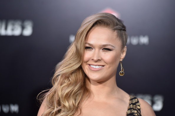 """HOLLYWOOD, CA - AUGUST 11: Actress Ronda Rousey attends Lionsgate Films' """"The Expendables 3"""" premiere at TCL Chinese Theatre on August 11, 2014 in Hollywood, California. (Photo by Frazer Harrison/Getty Images)"""