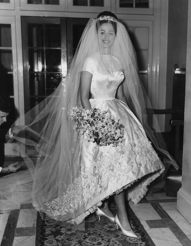 13th December 1960: Actress and author Jackie Collins celebrates her marriage to businessman Austin Wallace at Grosvenor House in London after a registry office ceremony. Her white satin wedding dress with intricate beading cost €400. (Photo by Central Press/Getty Images)