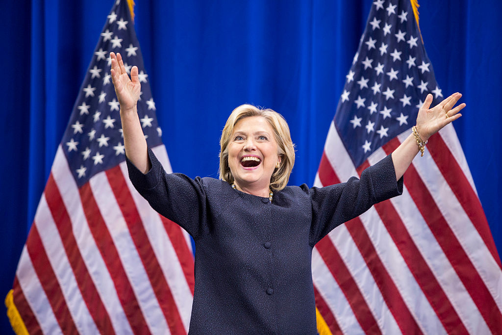 MANCHESTER, NH - SEPTEMBER 19: Democratic presidential candidate Hillary Clinton raises her arms stands on stage during the New Hampshire Democratic Party Convention at the Verizon Wireless Center on September 19, 2015 in Manchester, New Hampshire. Challenger for the democratic vote Sen. Bernie Sanders (I-VT) has been gaining ground on Clinton in Iowa and New Hampshire. (Photo by Scott Eisen/Getty Images)