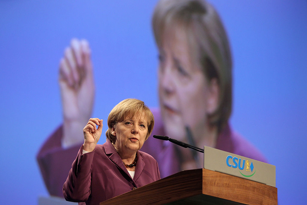MUNICH, GERMANY - OCTOBER 29: German Chancellor Angela Merkel addresses the audience during the CSU (Christian Social Union) party convention at Messe Muenchen on October 29, 2010 in Munich, Germany. The CSU members meet for a two day convention to discuss about the reform of the German armed forces (Bundeswehr). (Photo by Miguel Villagran/Getty Images)