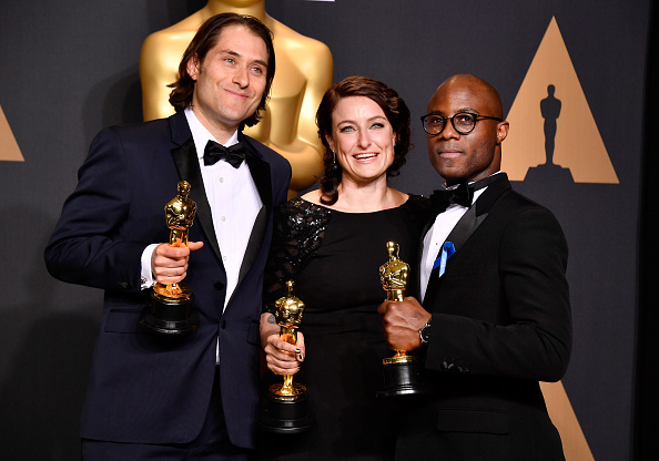 HOLLYWOOD, CA - FEBRUARY 26: (L-R) Producers Jeremy Kleiner (L) and Adele Romanski (C), winners of the award for Best Picture for'Moonlight,' pose with filmmaker Barry Jenkins in the press room during the 89th Annual Academy Awards.