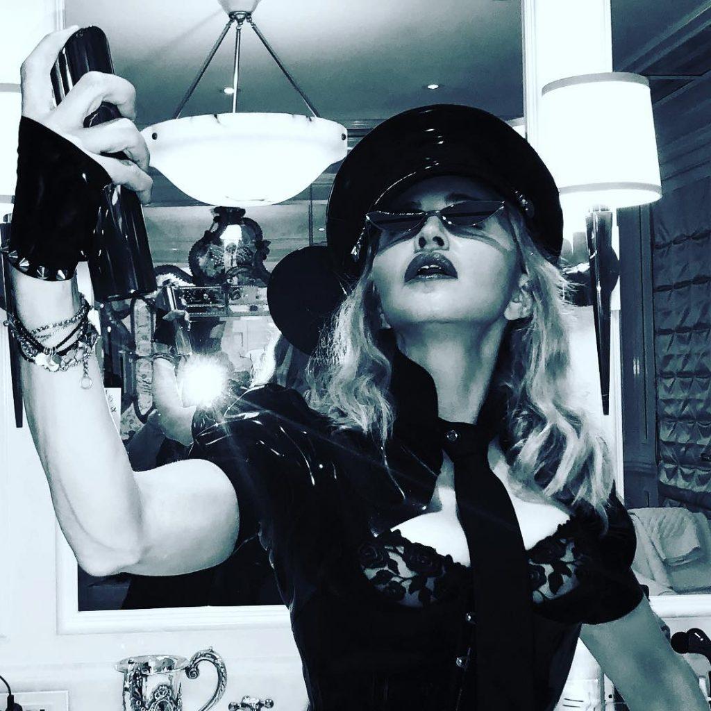 Madonna wears fingerless gloves