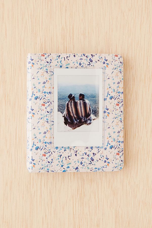 https://www.urbanoutfitters.com/shop/instax-patterned-photo-album-001?category=photo-albums-frames&color=068&quantity=1&size=ONE%20SIZE&type=REGULAR