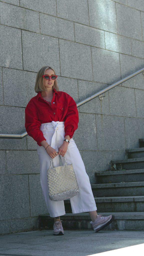 Red cropped denim jacket, €60 at topshop.com,Nike SportswearAir Max 98 in rose, €200 at nakedcph.com, woven shopper bag, €26 at topshop.com