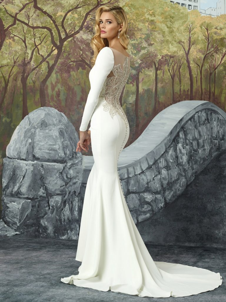Long-sleeved crepe wedding gown by Justin Alexander, available atmcelhinneysbridalrooms.com